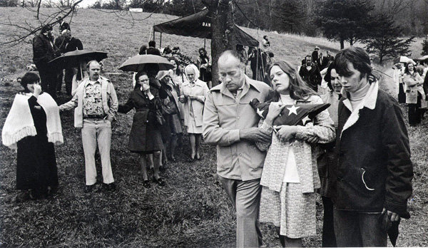 "(Photo by Earl Dotter) In the weeks after the 1976 Scotia Disaster, Letcher County was filled with funerals. Madonna Griffith holds a flag given to her husband, Robert Griffith, a 24-year-old Vietnam veteran from Jackhorn who died at Scotia. She was pregnant then with their second daughter, Misty. Misty Delph attended the recent commemoration of the tragedy. Photographer Earl Dotter entitled this photo ""Her husband survived Vietnam but not the Coal Mine."""