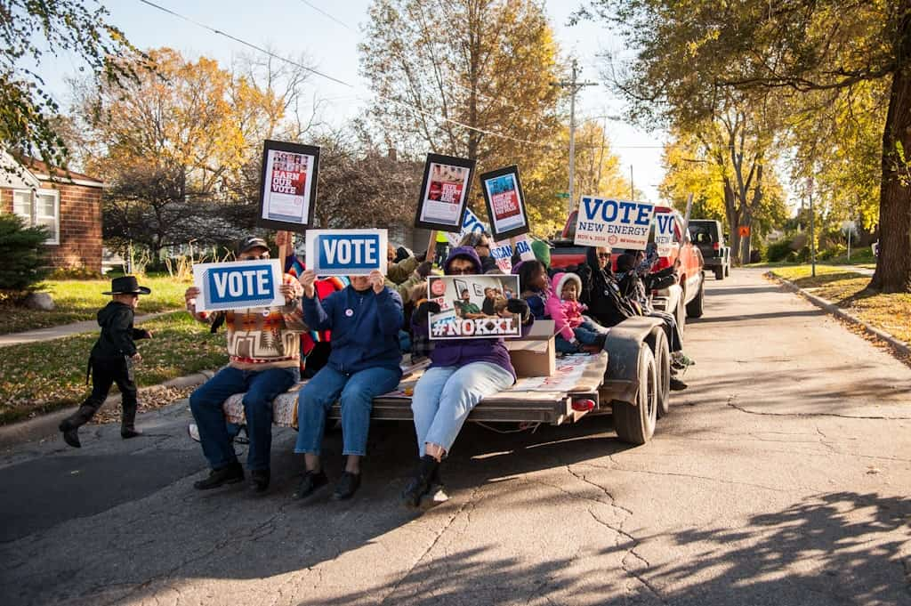 The Cowboy and Indian Alliance hit the streets of Omaha, Nebraska, to encourage folks to vote for New Energy candidates. Photo by J Grace Young / Bold Nebraska.