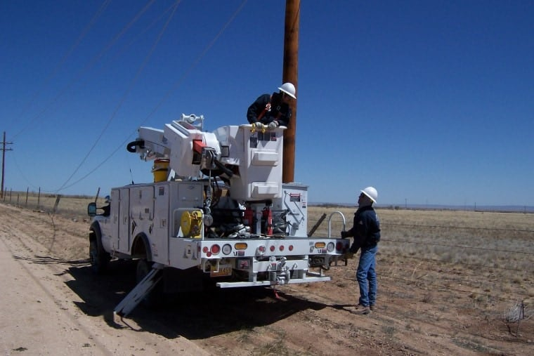 Workers for the Central New Mexico Electric Cooperative, Inc. service some lines.