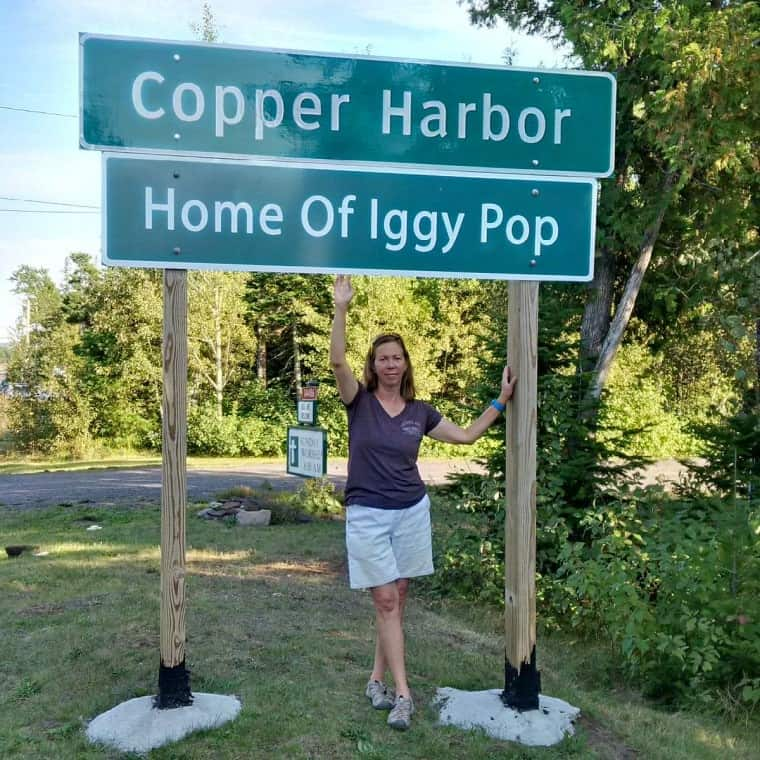 "The author under the ""Home of Iggy Pop"" sign."
