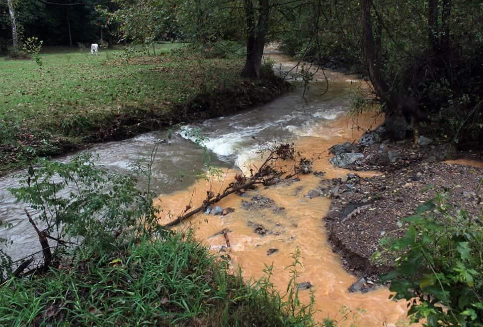 Residents say this photo shows uncontrolled soil runoff from the recently cleared Rock Springs pipeline right of way running into Fishing Creek during a rainstorm. Photo by David Jones.