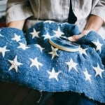 Stars are sewn into the flag made of industrial hemp that will fly over the Capitol November 11.  (Photo by Donnie Hedden 2015)