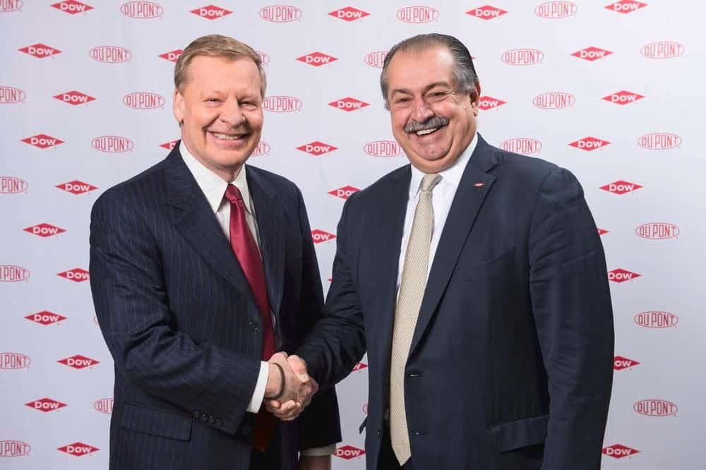 Breen, chairman and chief executive officer of DuPont, is pictured shaking hands with Liveris, Dow's chairman and chief executive officer, in this undated handout photo provided by DuPont
