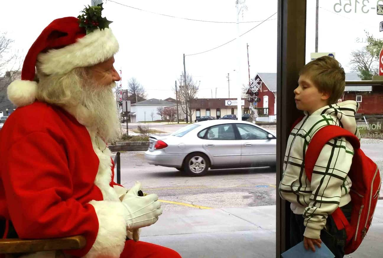 A Santa skeptic challenges St. Nick about the elf's existence. (Photo by Shannon L. Price)