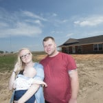 Paul and Morgan Sears stand in front of their self-help home in Broken Bow, Oklahoma. President Obama recommended a major cut in the USDA self-help housing program, but the final spending bill reversed that recommendation. (USDA photo by Lance Cheung)