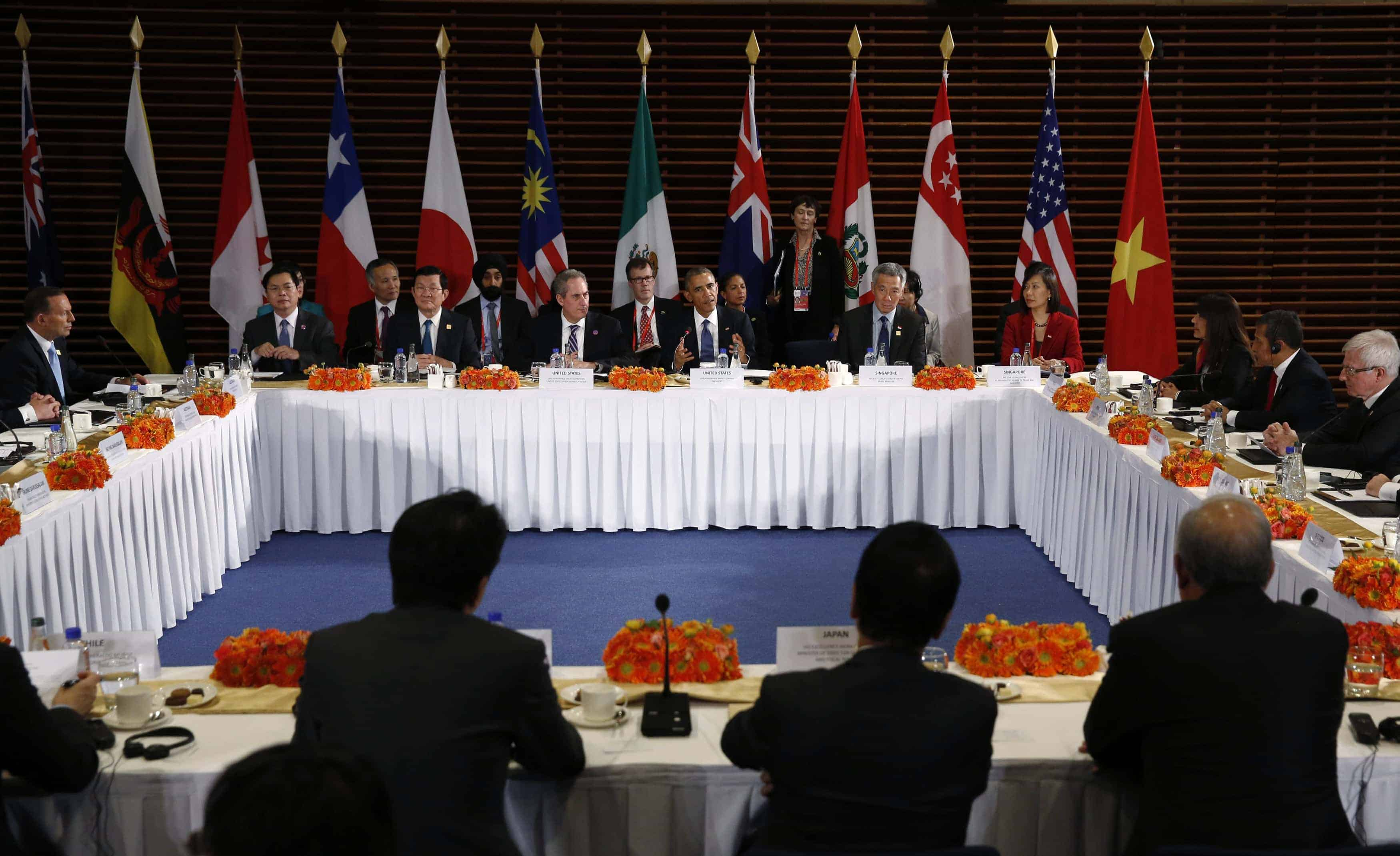 President Barack Obama (center) meets with the leaders of the Trans-Pacific Partnership (TPP) countries in Beijing last November. Photo by Kevin Lamarque/Reuters.