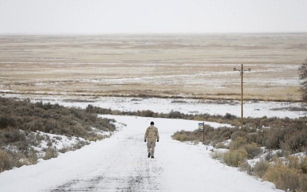 An occupier walks along a road at the Malheur National Wildlife Refuge near Burns, Oregon, Jan. 5, 2016. Photo by Jim Urquhart/Reuters.