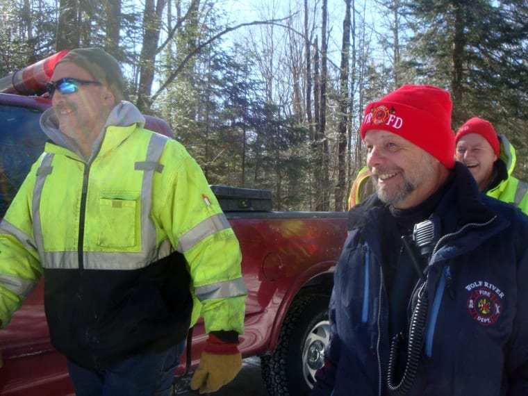 The author's husband and other firefighters responding to a call to assist with the evacuation of an injured snowmobiler.