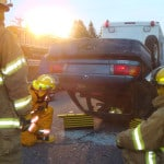 Rural volunteer firefighters train on patient extrication in motor vehicle rollovers.