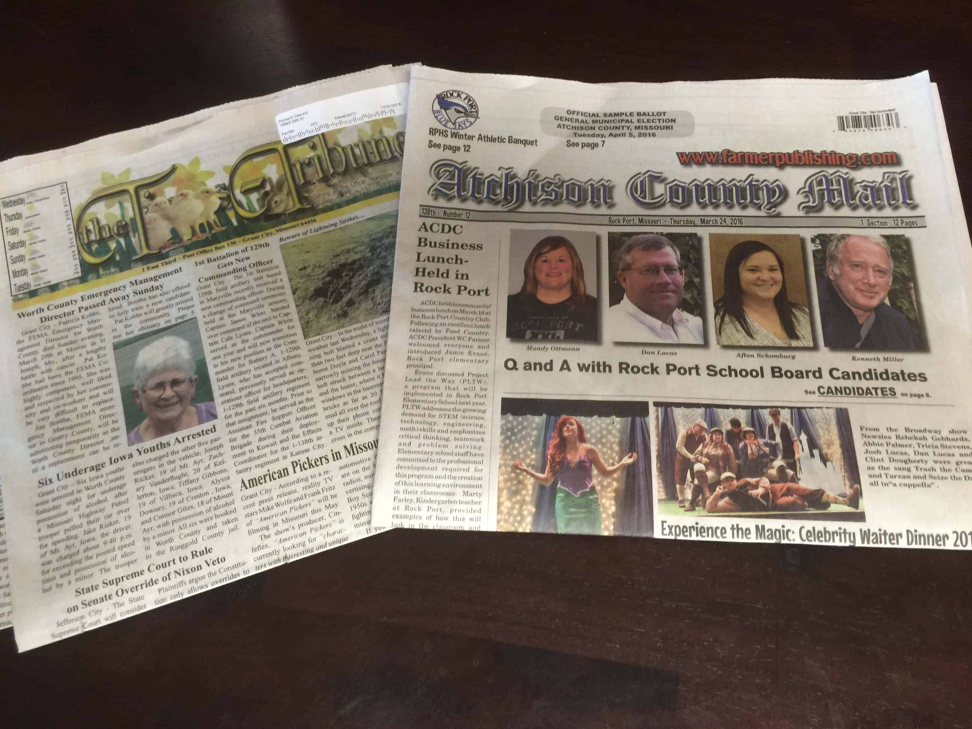 Two of the three community newspapers that serve parts of Atchison County, Missouri.  The school board candidates in the Atchison County Mail include Richard Oswald's  daughter, Mandy Ottman, on the left. The editor of the Times Tribune, Bridget Gibson, occasionally runs stories from the Yonder, Oswald says. (Photo by Richard Oswald)