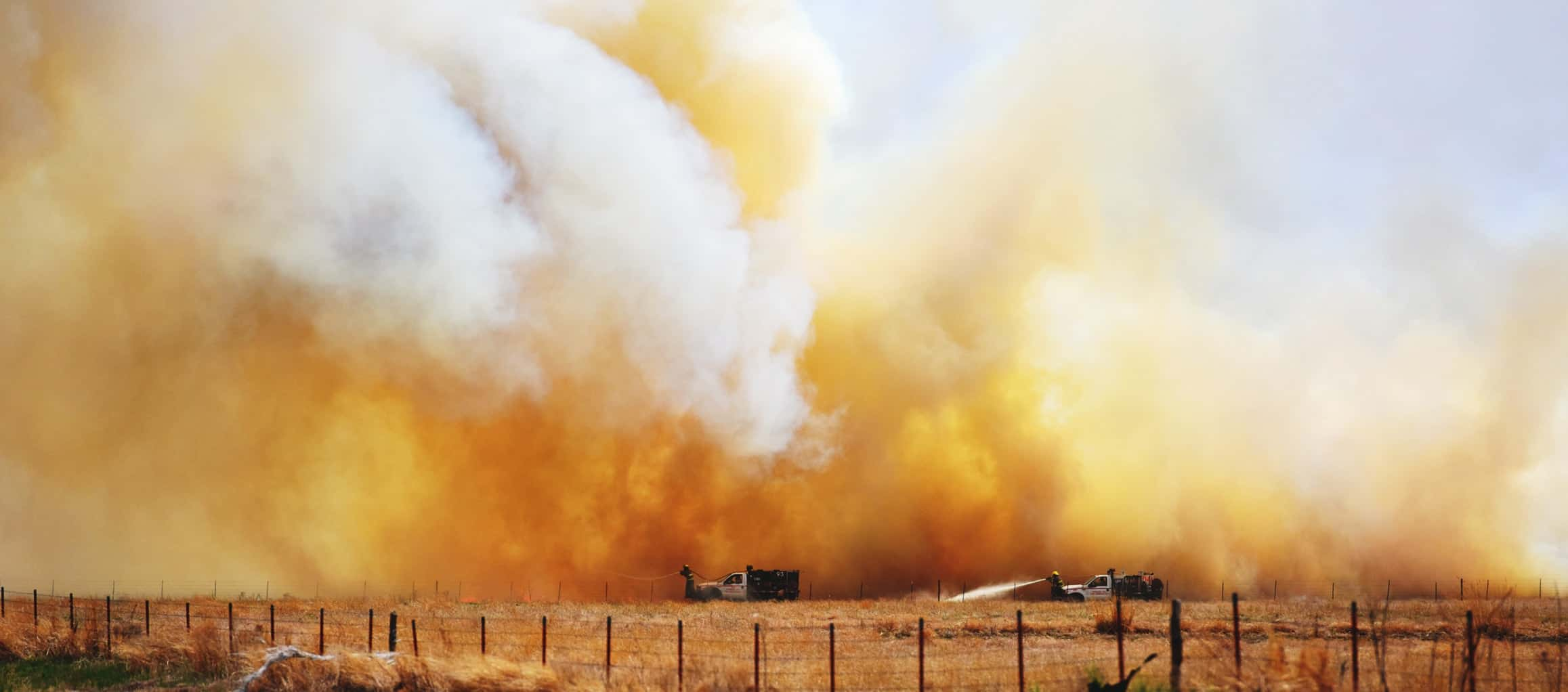 Firefighters battle another outbreak of wind-fueled wildfire west of 83-b