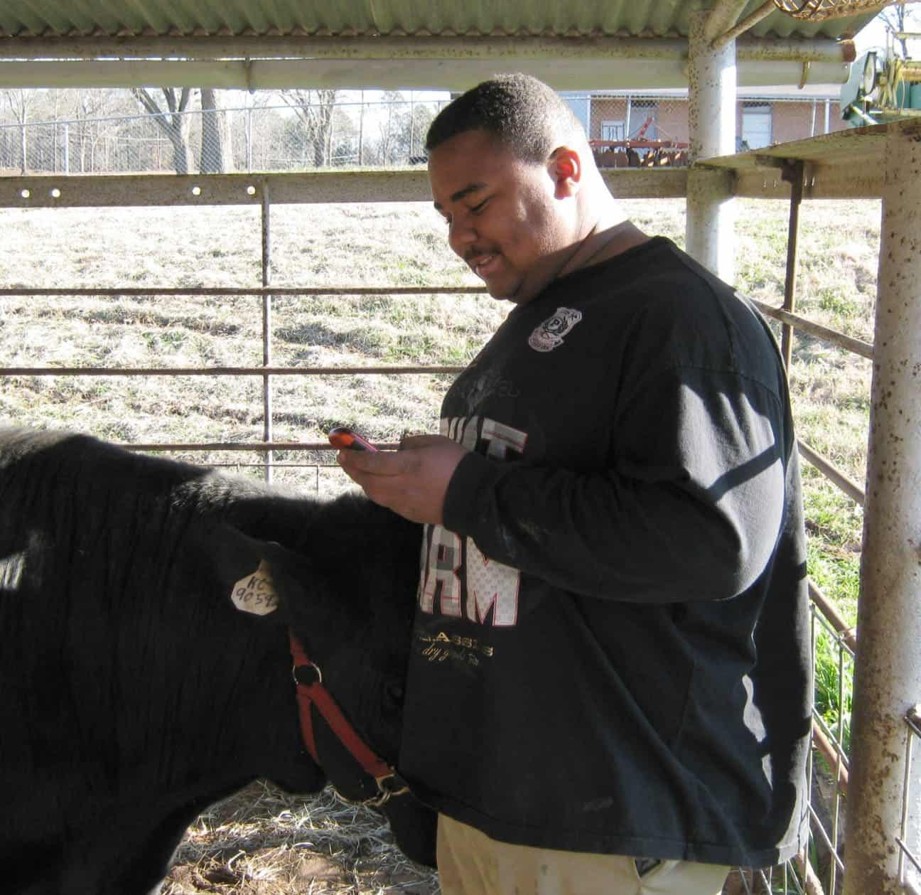 Just because you work the demonstration farm doesn't mean you're out of touch. Jerome checks his messages.