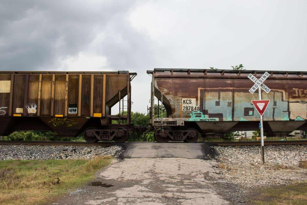 Coal cars line up on a railroad track that feeds the AES Shady Point generation plant near Panama, Oklahoma. Photo by Joe Wertz/StateImpact Oklahoma