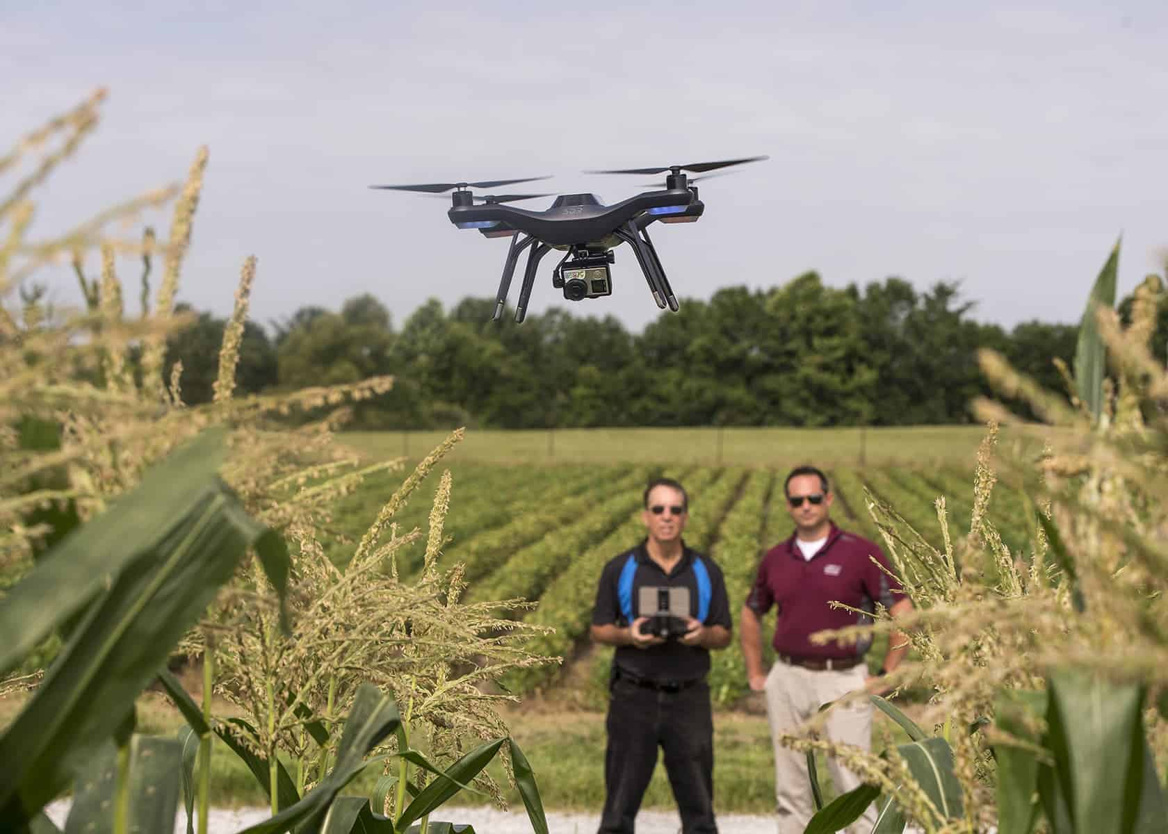 Two faculty members in the Department of Agricultural Systems and Education at Southern Illinois University Carbondale, test fly  a drone in a corn field. Photo by Russell Bailey