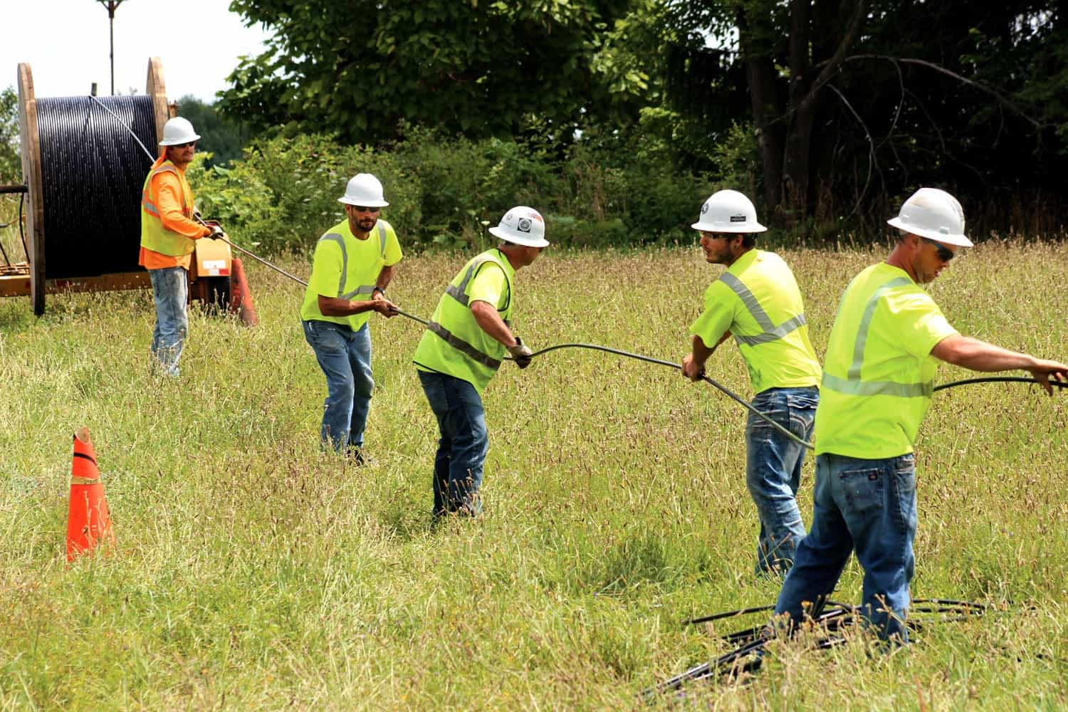 Members of a Midwest Energy Cooperative contract crew pull fiber cable in Schoolcraft, Michigan. Midwest is one provider that is developing hybrid systems the bring fixed-wireless access into the equation. Craig Settles says the combination can be a good option for getting rural communities online faster and getting community-focused networks off the ground. Photo courtesy Midwest Energy Cooperative.