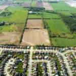 Suburban sprawl, adjacent to farmland.