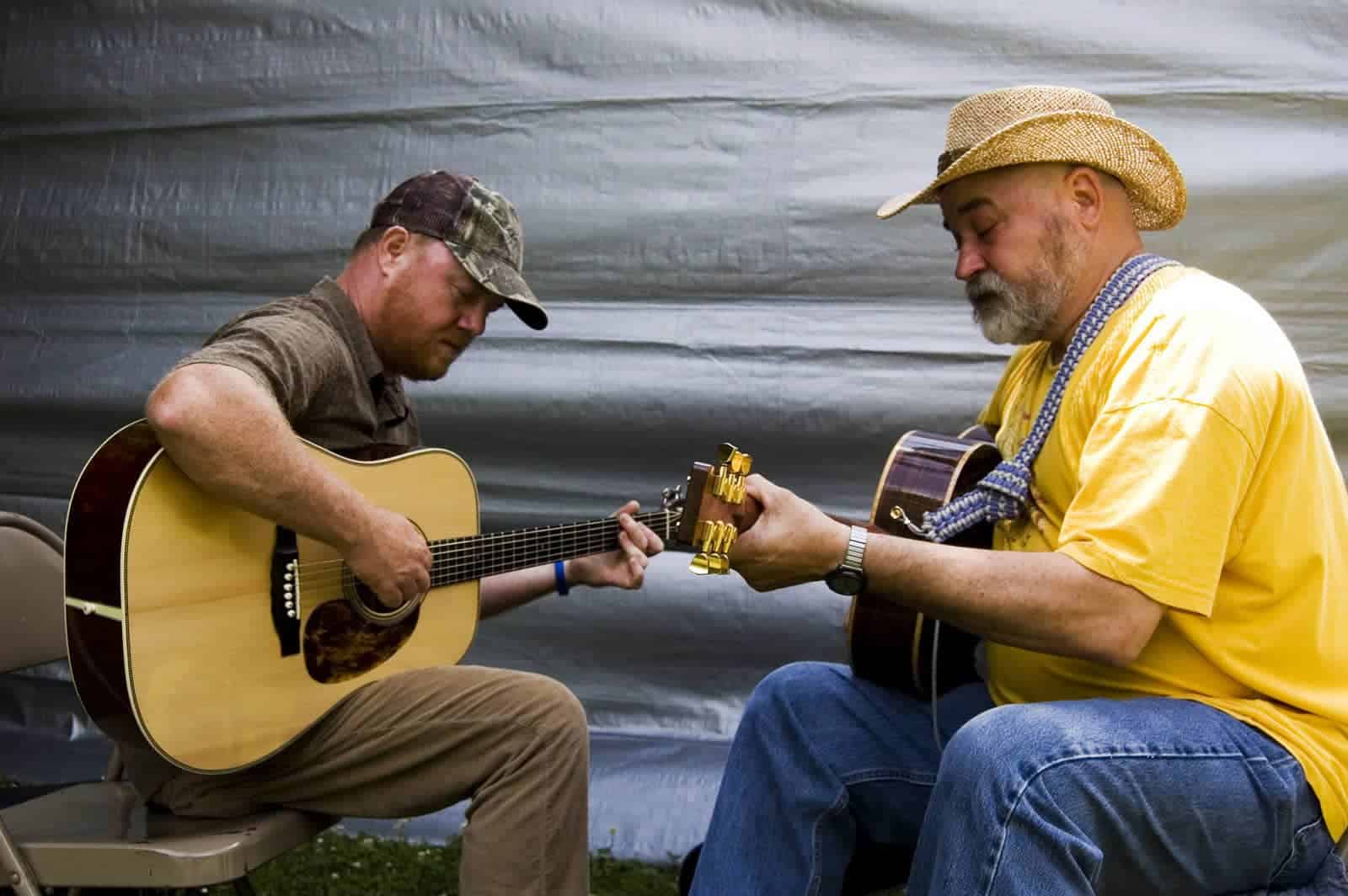 Appalachia has both a rich culture and many examples of success, despite what you might see on TV. A couple of participants in the guitar competition at the 2014 Wayne C Henderson Music Festival and Guitar Competition in Mouth of Wilson, Virginia. Photo by Virginia State Parks/Flickr
