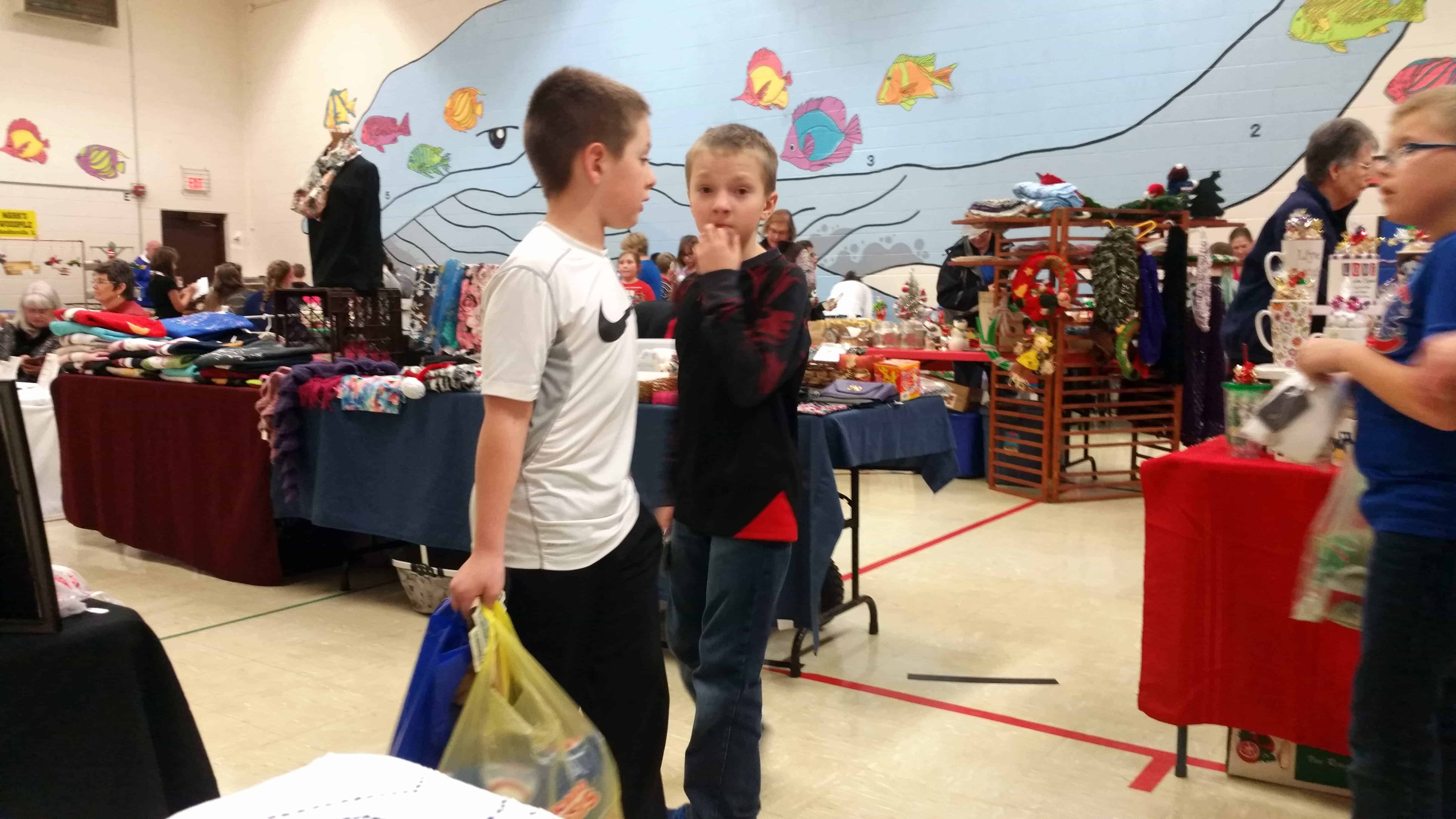 Students purchasing their gifts at the elementary school often strike a thoughtful pose.