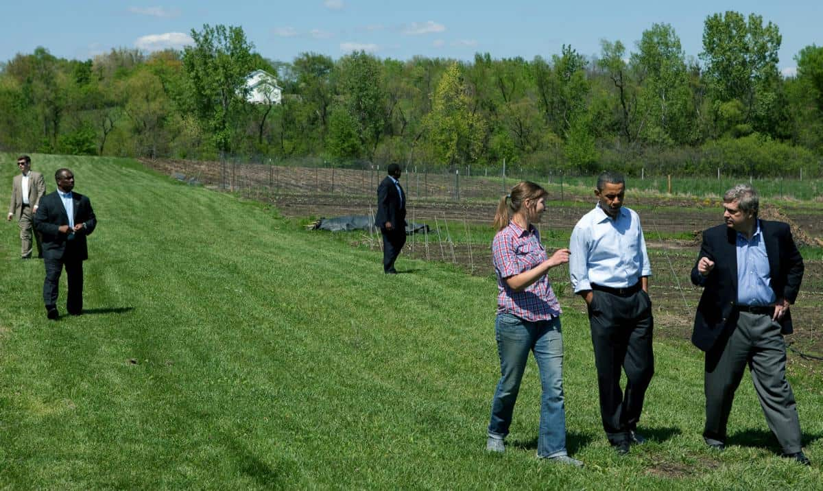 President Barack Obama tours MogoOrganic farm with Agriculture Secretary Tom Vilsack, right, and Morgan Hoenig, left, in Mount Pleasant, Iowa, in 2010. Official White House Photo by Pete Souza