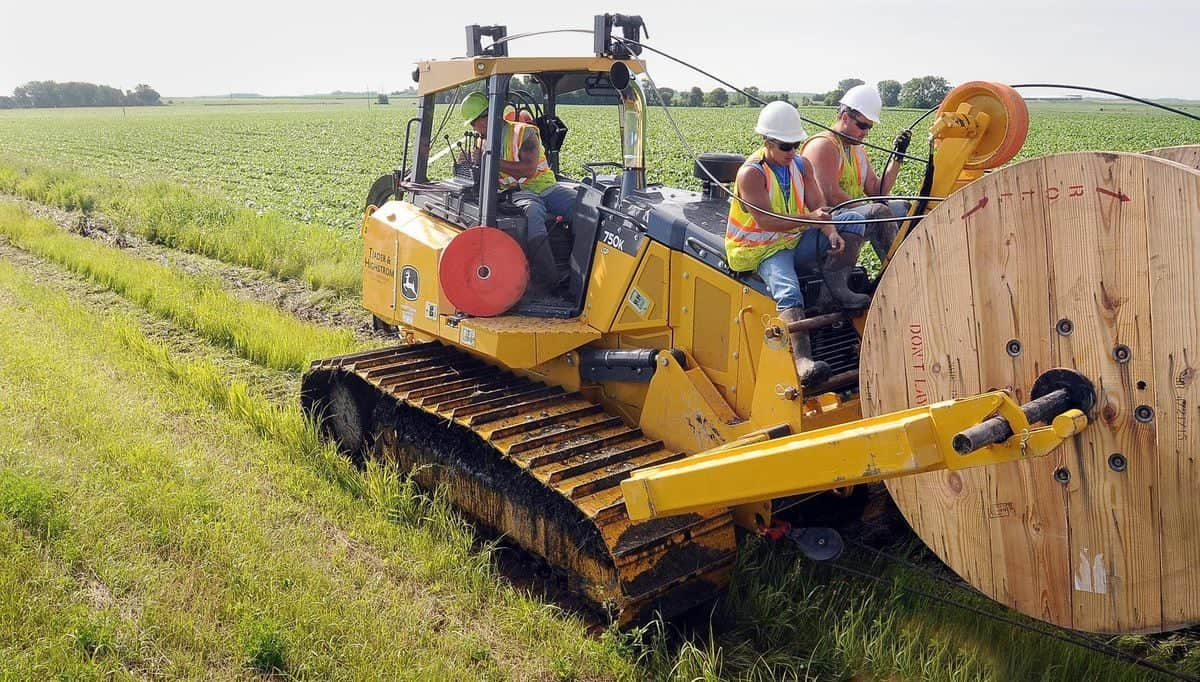 A crew from RS Fiber lays cable in rural Minnesota. The cooperative ran fiber to more densely populated parts of its service area, and used fixed wireless to get the network to harder-to-read areas quickly.