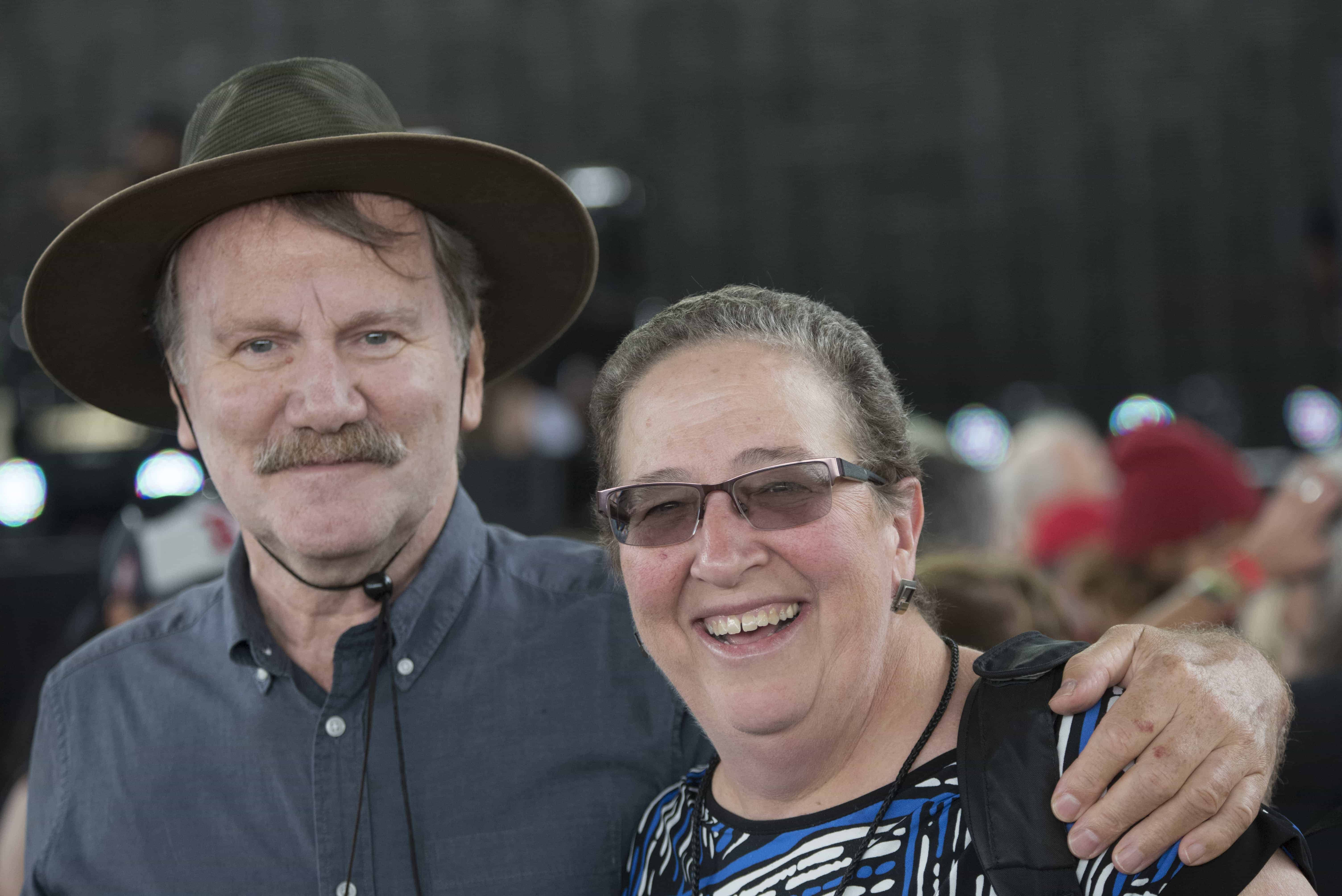 Kathy Ozer with husband David Battey, at Farm Aid 2016. Photo by Scott Streble