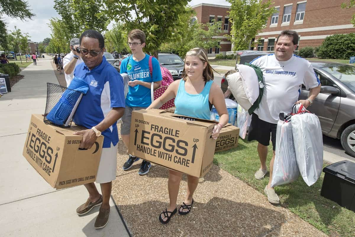 speak your piece giving rural college students a bigger break sidney a mcphee mtsu president left helps we haul volunteer graem merritt sophomore move freshman macie mussleman second from right along her