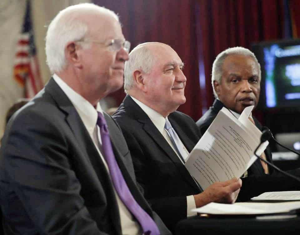 Former Georgia Governor Sonny Perdue (center) was introduced by former Georgia Senator Saxby Chambliss (left). Georgia member of Congress David Scott (right, D-13th) expressed his support for the nomination and addressed controversy over the Confederate battle flag that occurred while Perdue was governor.