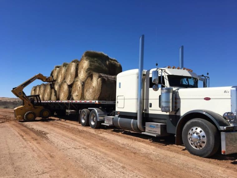 Loading hay onto a truck in the Yooper Relief Convoy group. A Yooper slang for someone from Michigan's Upper Peninsula. Photo via the Yooper Relief Convoy's Facebook page.