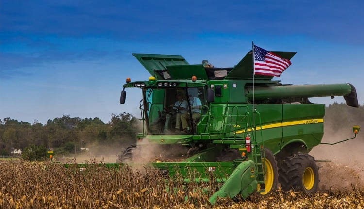 A combine in action. (Photo by Wesley Hetrick, Flickr, Creative Commons)